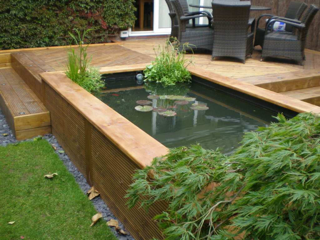 Blog hillsborough fencing sheffield railway sleeper for Raised koi pond construction