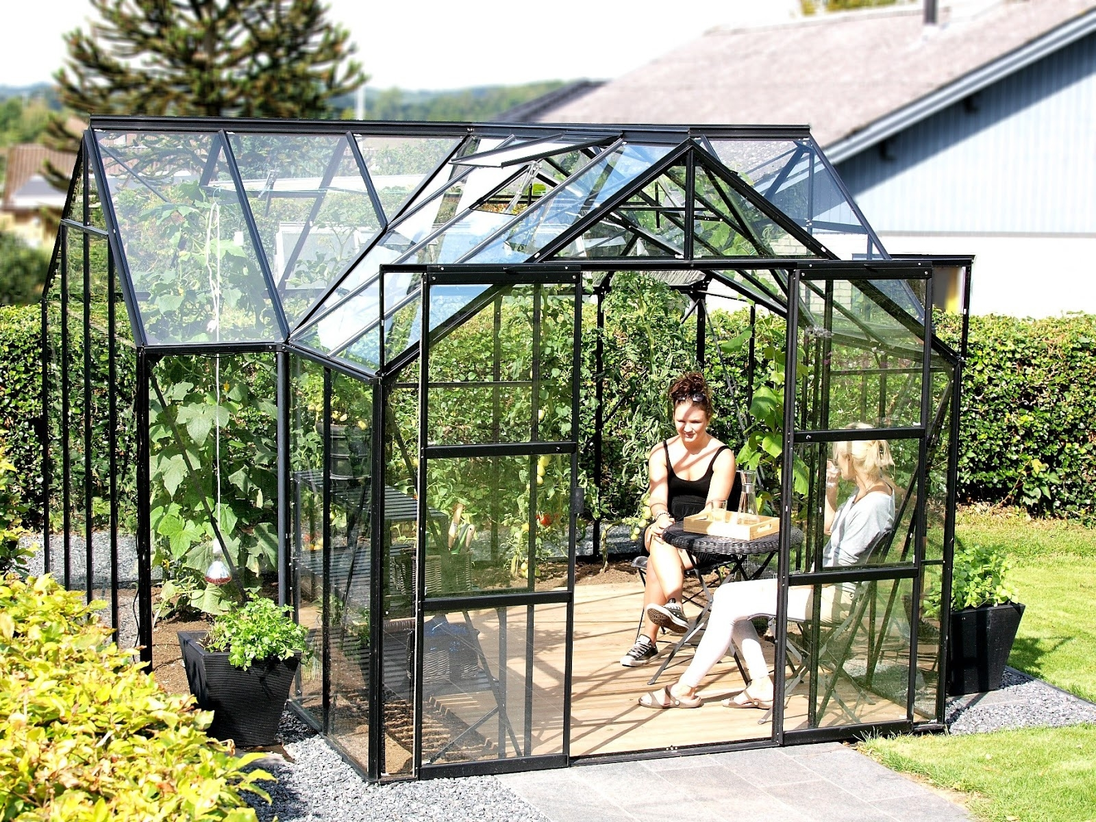 People sit in greenhouse